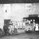 Photo showing G T Alcock, butchers in the 1900s. The boy on the left could be Edmund Astell