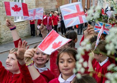 Union flags and Canadian flags being waved in Church Street