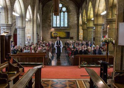 Rev Craig Groocock enters the church
