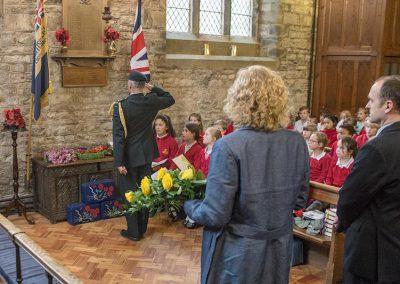 Lt Col Rushen salutes the church war memorial
